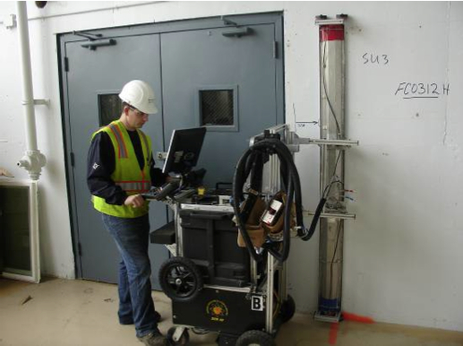 Scanning a wall for radiological contamination.  Navy photo.