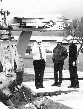 Removing jet fuel line in OU-2B cleanup area in 1999.  Jet monument is in background.