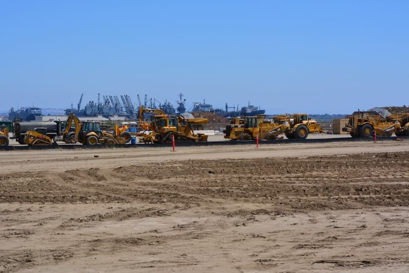 Construction equipment at Site 2.  Looking east with maritime ships in background.