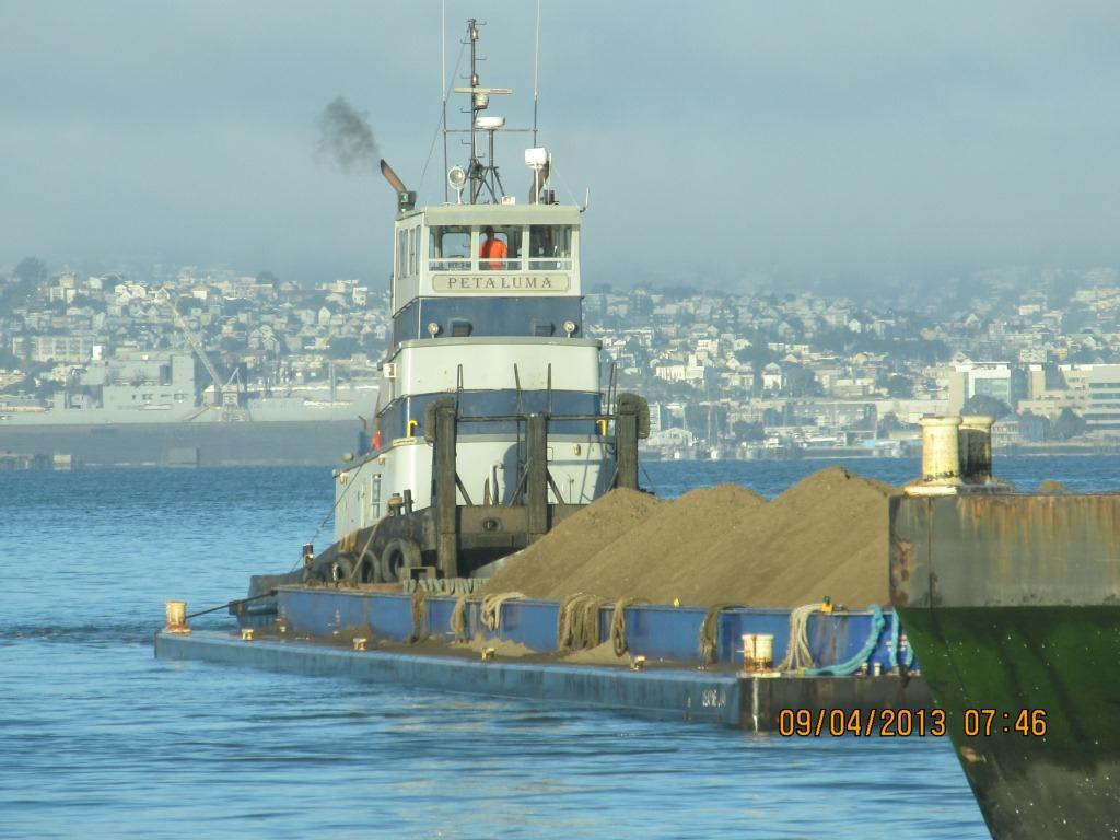 Soil being delivered from Decker Island.