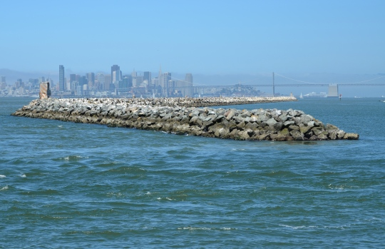 Breakwater Island.  Alameda Point is to the right.  San Francisco Bay is to the left.  San Francisco is in the background.