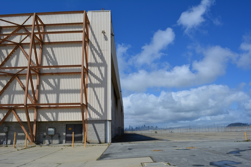 "55-foot tall ""Building 25"" that will be protected by a levee, and remind campers that they are on an old military industrial site, as they gaze at the night stars."