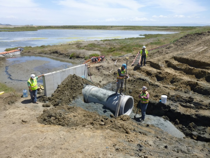 New culvert being installed connecting San Francisco Bay, which is to the right, and North Pond of the West Wetland at Alameda Point.  Navy photo taken 5/22/14.