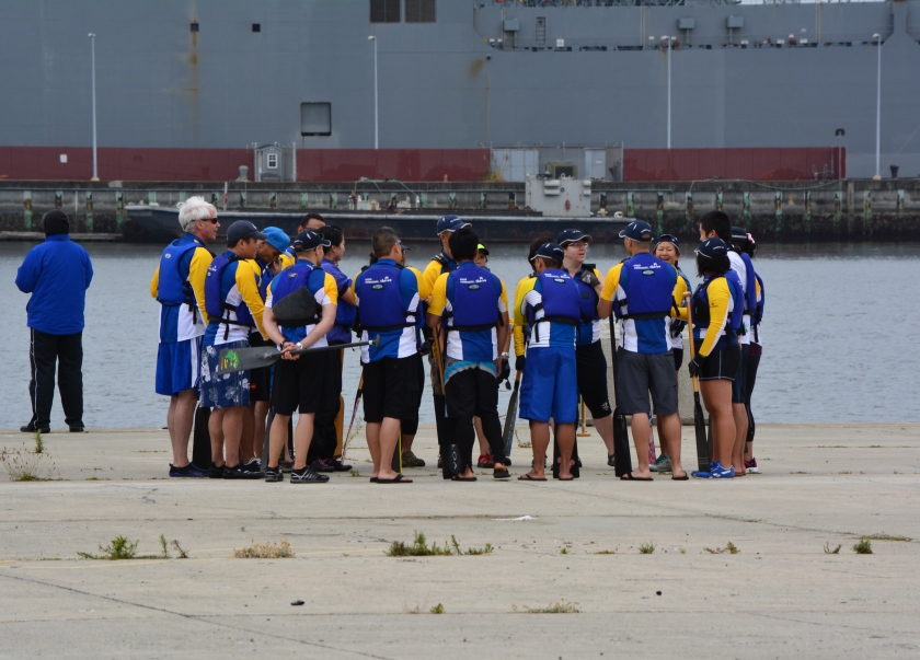 Dragon boat team huddle
