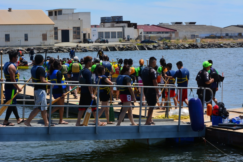 Dragon boat teams boarding their boats