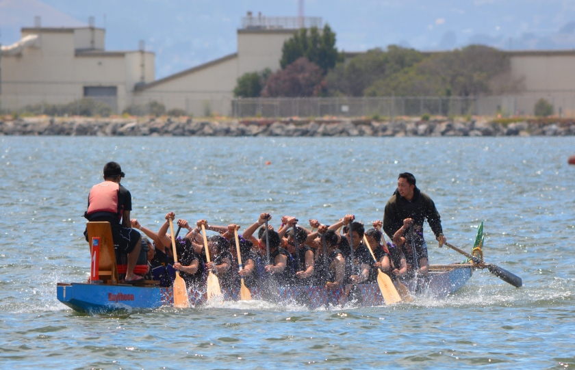 Dragon boat team competing in race at Alameda Point's Seaplane Lagoon.