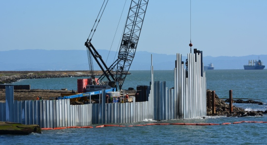 Three of the waste isolation cells under construction at northwestern tip of Alameda Point.  A total of 15  cells, each one separated by a wall behind the face of the barrier, will be constructed here.