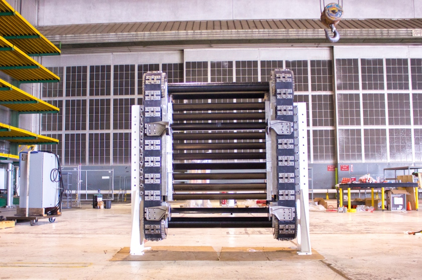 HydroEngine drive system called a cassette.  Blades connected to conveyor belts are moved by water guided by fins called guidevanes (not shown).  As water contacts first set of blades, the belt is moved upward, while exiting water drives the  rear set of blades downward.  Natel Energy photo.  Used by permission.