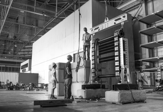 Employees moving the cassette in new production facility. Natel Energy photo. Used by permission.