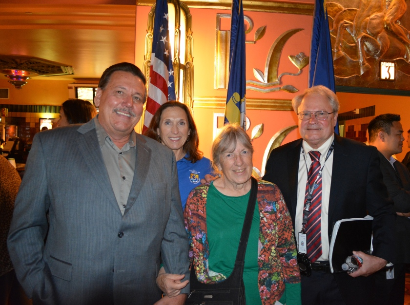 Navy Property Caretaker Doug Delong, U.S. Fish & Wildlife Service tern colony manager Susan Euing, Golden Gate Audubon Society and Friends of the Alameda Wildlife Reserve's Leora Feeney, and VA project manager Larry Janes in the lobby of the Alameda Theater after the transfer ceremony.