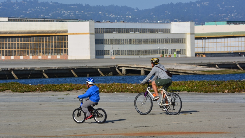 Mother and son cycling on west side of Seaplane Lagoon.