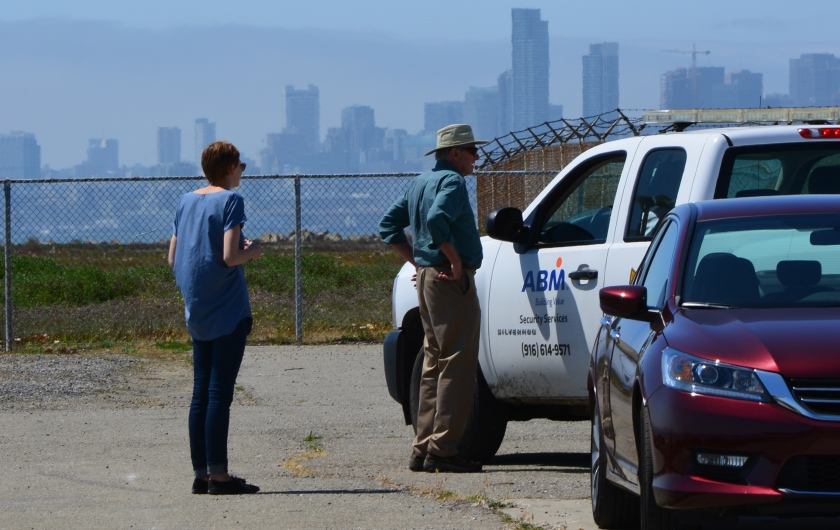Two visitors to west side of Seaplane Lagoon shoreline being ordered to leave by security.