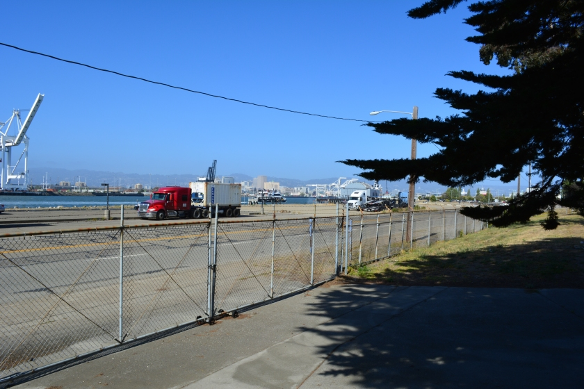Main Street entrance to O Club parking lot.  Oakland Estuary and arriving ferry on the left.