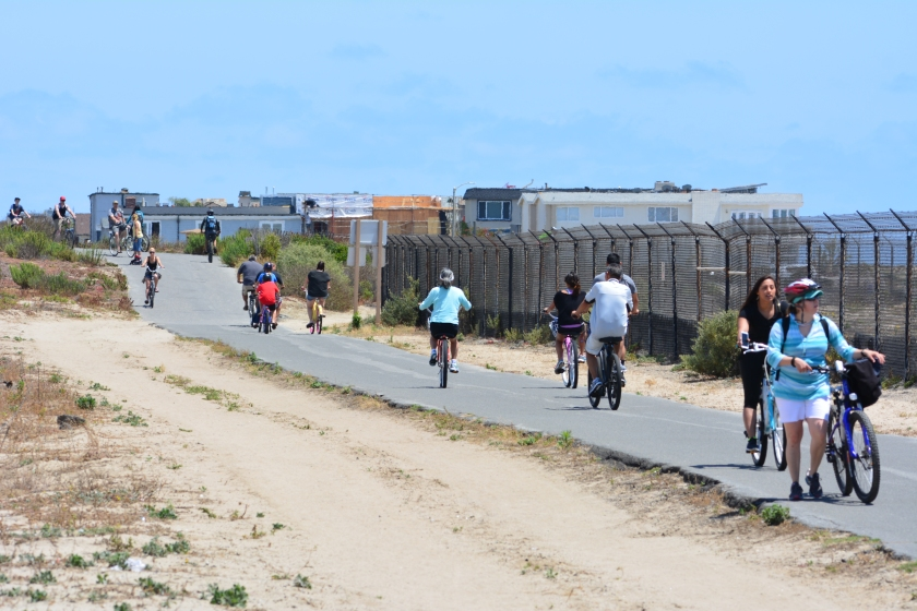 Huntington Beach Bike Trail.  Least tern preserve is on the right.  Pacific Coast Highway is about 20 feet to the left and out of view.  City of Newport Beach is in the background.