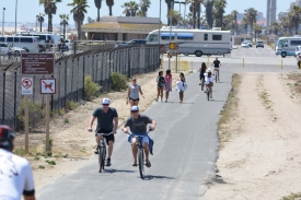 Cyclists on Huntington Beach Bike Trail on Memorial Day weekend 2015.