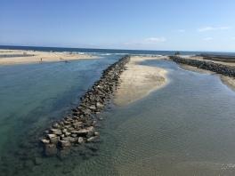 Santa Ana River. Newport Beach on the left, Huntington Beach on the right.