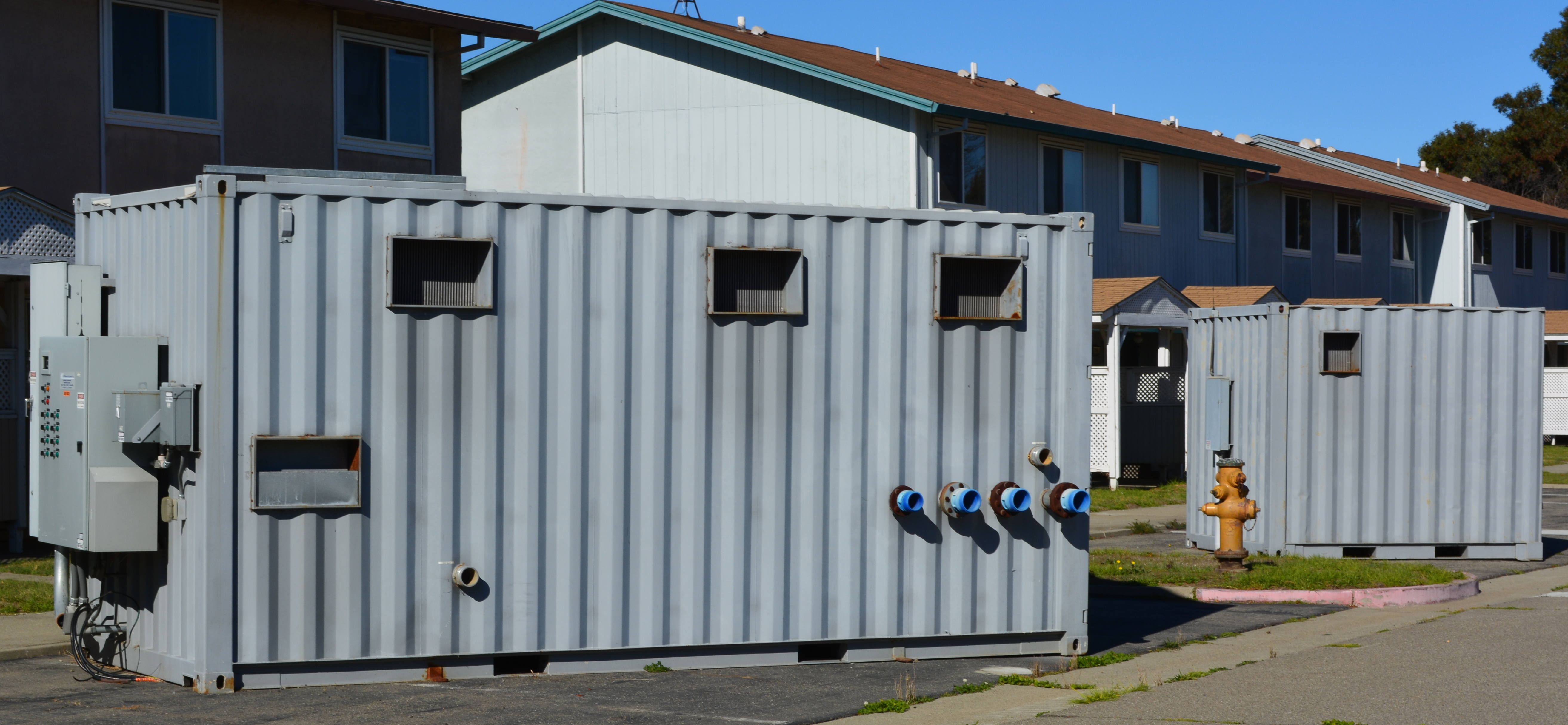 Control module with pumps for groundwater cleanup system waiting to be hauled away from North Housing.