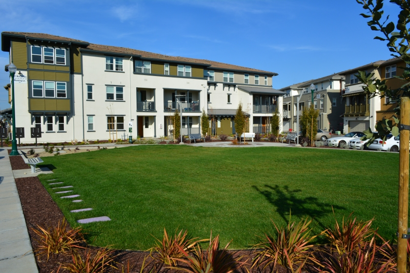 Generous landscaping complements the loft-style condominiums at Alameda Landing near Target.