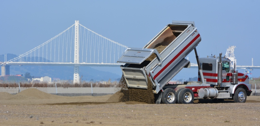 Sand being delivered to the least tern nesting grounds at Alameda Point on February 25, 2016. Bay Bridge in the background.