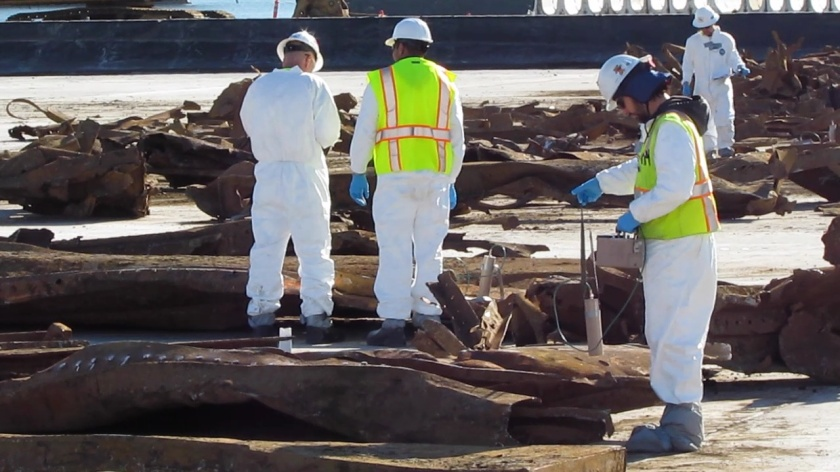 Navy contractor scanning the remnants of an old barge for radiation in January 2012. The barge had to be demolished and removed piece by piece from the northwest corner of the Seaplane Lagoon prior to dredging. No radiation was found. The Navy recycled the metal.
